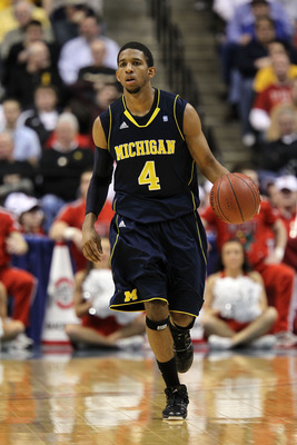 INDIANAPOLIS, IN - MARCH 12:  Darius Morris #4 of the Michigan Wolverines brings the ball up court against the Ohio State Buckeyes during the semifinals of the 2011 Big Ten Men's Basketball Tournament at Conseco Fieldhouse on March 12, 2011 in Indianapoli