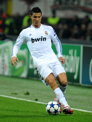 MILAN, ITALY - NOVEMBER 03:  Cristiano Ronaldo of Real Madrid in action during the UEFA Champions League Group G match between AC Milan and Real Madrid at Stadio Giuseppe Meazza on November 3, 2010 in Milan, Italy.  (Photo by Massimo Cebrelli/Getty Images