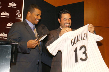 CHICAGO - NOVEMBER 3:  Chicago White Sox General Manager Ken Williams (L) presents new Manager Ozzie Guillen, a former shortstop for the club, with a jersey at a news conference November 3, 2003 at U.S. Cellular Field in Chicago, Illinois.  (Photo by Jona