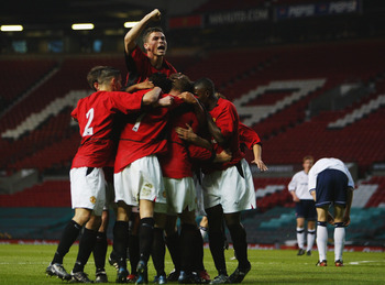MANCHESTER - APRIL 25:  Manchester United youth players celebrate during the FA Youth Cup Final, second leg match between Manchester United and Middlesbrough on April 25, 2003 at Old Trafford in Manchester, England.  Manchester United won the final 3-1 on