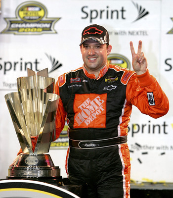 HOMESTEAD, FL - NOVEMBER 20:  Tony Stewart, driver of the #20 Home Depot Chevrolet, celebrates winning the NASCAR Nextel Cup Championship after the Ford 400 on November 20, 2005 at Homestead-Miami Speedway in Homestead, Florida.  (Photo By Streeter Lecka/