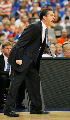 ATLANTA, GA - MARCH 13:  Head coach John Calipari of the Kentucky Wildcats coaches against the Florida Gators during the championship game of the SEC Men's Basketball Tournament at Georgia Dome on March 13, 2011 in Atlanta, Georgia.  (Photo by Kevin C. Co