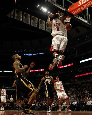 CHICAGO - FEBRUARY 24: Derrick Rose #1 of the Chicago Bulls leaps to dunk the ball against the Indiana Pacers at the United Center on February 24, 2010 in Chicago, Illinois. The Bulls defeated the Pacers 120-110. NOTE TO USER: User expressly acknowledges