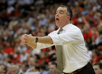 JACKSONVILLE, FL - MARCH 19:  Mike Young head coach of the Wofford Terriers yells out to his team while facing the Wisconsin Badgers during the first round of the 2010 NCAA men's basketball tournament at Jacksonville Veteran's Memorial Arena on March 19,