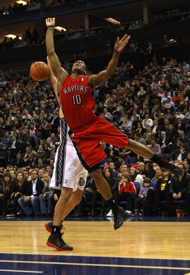 LONDON, ENGLAND - MARCH 04:  #10 DeMar DeRozan of the Raptors jumps to defence a shot at goal during the NBA match between New Jersey Nets and the Toronto Raptors at the O2 Arena on March 4, 2011 in London, England. NOTE TO USER: User expressly acknowledg