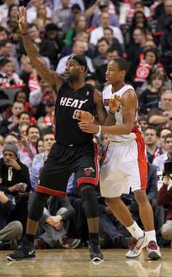 TORONTO, CANADA - FEBRUARY 16:  LeBron James #6 of the Miami Heat calls for a ball while being defended by DeMar DeRozan #10 of the Toronto Raptors in a game on February 16, 2011 at the Air Canada Centre in Toronto, Canada. The Heat defeated the Raptors 1