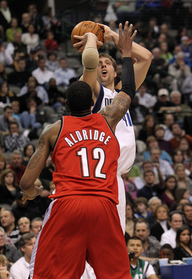 DALLAS - JANUARY 30:  Forward Dirk Nowitzki #21 of the Dallas Mavericks takes a shot against LaMarcus Aldridge #12 of the Portland Trail Blazers on January 30, 2010 at American Airlines Center in Dallas, Texas.  NOTE TO USER: User expressly acknowledges a