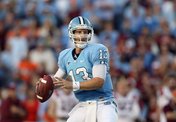 CHAPEL HILL, NC - NOVEMBER 13:  T.J. Yates #13 of the North Carolina Tar Heels drops back to throw a pass against the Virginia Tech Hokies during their game at Kenan Stadium on November 13, 2010 in Chapel Hill, North Carolina.  (Photo by Streeter Lecka/Ge