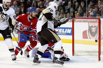 MONTREAL- MAY 10:  Sidney Crosby #87 of the Pittsburgh Penguins scores a goal on Jaroslav Halak #41 of the Montreal Canadiens in Game Six of the Eastern Conference Semifinals during the 2010 NHL Stanley Cup Playoffs at the Bell Centre on May 10, 2010 in M