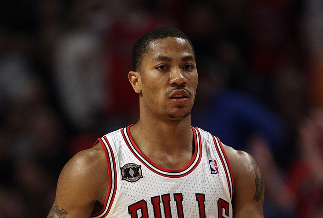CHICAGO, IL - MARCH 12: Derrick Rose #1 of the Chicago Bulls walks back to the bench after hitting a 3 point shot against the Utah Jazz at the United Center on March 12, 2011 in Chicago, Illinois. The Bulls defeated the Jazz 118-100. NOTE TO USER: User ex