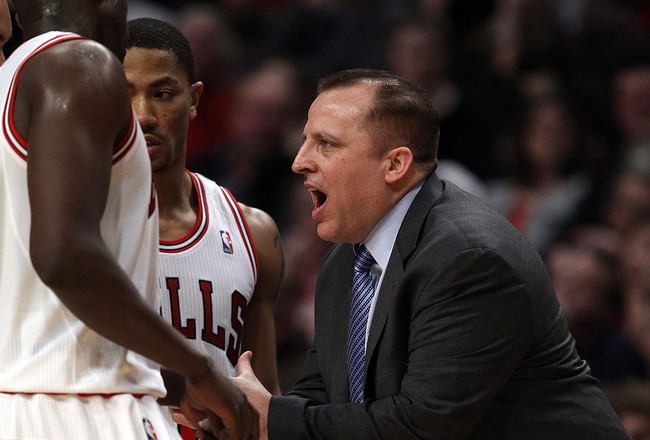 CHICAGO, IL - MARCH 12: Head coach Tom Thibodeau of the Chicago Bulls gives instructions to Loul Deng #9 and Derrick Rose #1 against the Utah Jazz at the United Center on March 12, 2011 in Chicago, Illinois. The Bulls defeated the Jazz 118-100. NOTE TO US