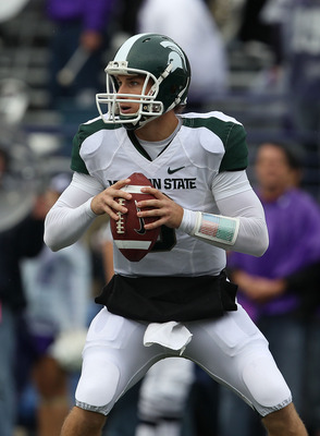 EVANSTON, IL - OCTOBER 23: Kirk Cousins #8 of the Michigan State Spartans looks for a receiver against the Northwestern Wildcats at Ryan Field on October 23, 2010 in Evanston, Illinois. Michigan State defeated Northwestern 35-27. (Photo by Jonathan Daniel