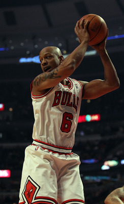 CHICAGO, IL - DECEMBER 21: Keith Bogans #6 of the Chicago Bulls grabs a rebound against the Philadelphia 76ers at the United Center on December 21, 2010 in Chicago, Illinois. The Bulls defeated the 76ers 121-76. NOTE TO USER: User expressly acknowledges a