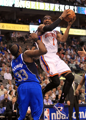 DALLAS, TX - MARCH 10:  Amar'e Stoudemire #1 of the New York Knicks takes a shot against Brendan Haywood #33 of the Dallas Mavericks at American Airlines Center on March 10, 2011 in Dallas, Texas.  NOTE TO USER: User expressly acknowledges and agrees that