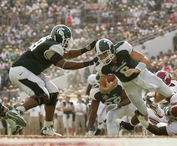 ORLANDO, FL - JANUARY 01:  Kirk Cousins #8  of the Michigan State Spartans is sacked by Courtney Upshaw #41 of the Alabama Crimson Tide during the Capitol One Bowl at the Florida Citrus Bowl on January 1, 2011 in Orlando, Florida.  (Photo by Mike Ehrmann/