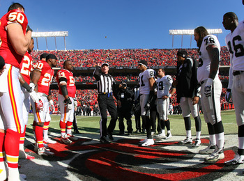 KANSAS CITY, MO - JANUARY 02:  Team captains for the Kansas City Chiefs and the Oakland Raiders meet for the coin toss before a game at Arrowhead Stadium on January 2, 2011 in Kansas City, Missouri.  (Photo by Tim Umphrey/Getty Images)