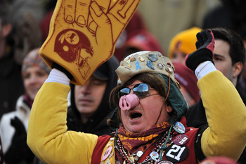 LANDOVER, MD - DECEMBER 6:  A fan of the Washington Redskins cheers against the New Orleans Saints at FedExField on December 6, 2009 in Landover, Maryland. The Saints defeated the Redskins in overtime 33-30. (Photo by Larry French/Getty Images)