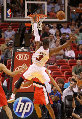 MIAMI, FL - MARCH 08: Dwyane Wade #3 of the Miami Heat loses the ball during a game against the Portland Trail Blazers at American Airlines Arena on March 8, 2011 in Miami, Florida. NOTE TO USER: User expressly acknowledges and agrees that, by downloading