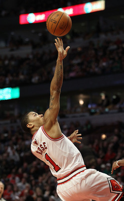 CHICAGO, IL - MARCH 12: Derrick Rose #1 of the Chicago Bulls puts up a shot against the Utah Jazz at the United Center on March 12, 2011 in Chicago, Illinois. The Bulls defeated the Jazz 118-100. NOTE TO USER: User expressly acknowledges and agrees that,