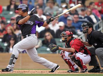 SCOTTSDALE, AZ - FEBRUARY 26:  Jose Lopez #22 of the Colorado Rockies swings against the Arizona Diamondbacks at Salt River Fields on February 26, 2011 in Scottsdale, Arizona..  (Photo by Jonathan Ferrey/Getty Images)