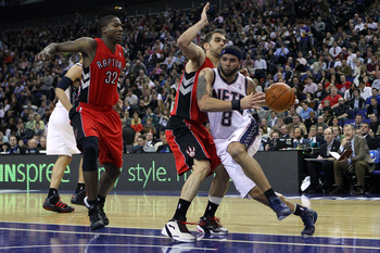 LONDON, ENGLAND - MARCH 04:  Deron Williams of the Nets runs past the Raptors defence during the NBA match between New Jersey Nets and the Toronto Raptors at the O2 Arena on March 4, 2011 in London, England. NOTE TO USER: User expressly acknowledges and a