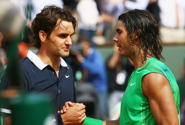 PARIS - JUNE 08:  Rafael Nadal of Spain shakes hands with Roger Federer (L) of Switzerland, followinghis victory during the Men's Singles Final match on day fifteen of the French Open at Roland Garros on June 8, 2008 in Paris, France.  (Photo by Julian Fi