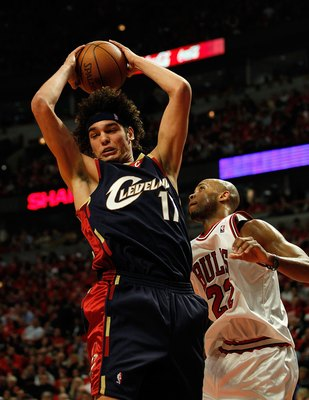 CHICAGO - APRIL 22: Anderson Varejao #17 of the Cleveland Cavaliers grabs a rebound over Taj Gibson #22 of the Chicago Bulls in Game Three of the Eastern Conference Quarterfinals during the 2010 NBA Playoffs at the United Center on April 22, 2010 in Chica