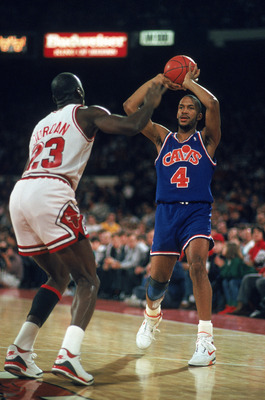 1989:  Ron Harper of the Cleveland Cavaliers holds the ball as Michael Jordan plays defense in Chicago, Illinois during the 1988-1989 NBA season. Mandatory Credit:  Jonathan Daniel/Getty Images