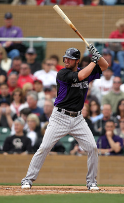 SCOTTSDALE, AZ - FEBRUARY 26:  Ian Stewart #9 of the Colorado Rockies swings during the game against the Arizona Diamondbacks at Salt River Fields on February 26, 2011in Scottsdale, Arizona..  (Photo by Jonathan Ferrey/Getty Images)