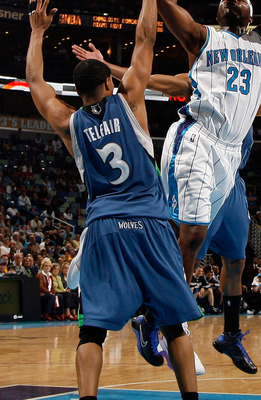 NEW ORLEANS - FEBRUARY 08:  Devin Brown #23 of the New Orleans Hornets makes a shot over Sebastian Telfair #3 of the Minnesota Timberwolves on February 8, 2009 in New Orleans, Louisiana.  The Hornets defeated the Timberwolves 101-97.  NOTE TO USER: User e