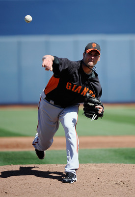 PEORIA, AZ - MARCH 08:  Ryan Vogelsong #32 of the San Francisco Giants throws against the Seattle Mariners during the spring training baseball game against at Peoria Stadium on March 8, 2011 in Peoria, Arizona.  (Photo by Kevork Djansezian/Getty Images)
