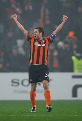 DONETSK, UKRAINE - NOVEMBER 03:  Darijo Srna of Shakhtar Donetsk celebrates victory after the Champions League Group H match between FC Shakhtar Donetsk and Arsenal at the Donbass Arena on November 3, 2010 in Donetsk, Ukraine.  (Photo by Laurence Griffith