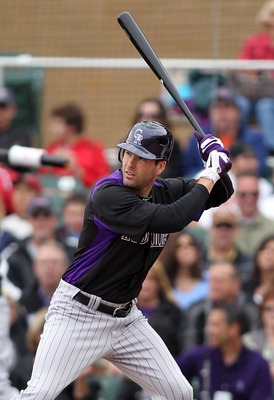 SCOTTSDALE, AZ - FEBRUARY 26:  Seth Smith #7 of the Colorado Rockies swings against the Arizona Diamondbacks at Salt River Fields on February 26, 2011 in Scottsdale, Arizona..  (Photo by Jonathan Ferrey/Getty Images)