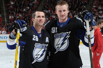 RALEIGH, NC - JANUARY 29:  Martin St. Louis #26 and Steven Stamkos #91 of the Tampa Bay Lightning look on during the Honda NHL SuperSkills competition part of 2011 NHL All-Star Weekend at the RBC Center on January 29, 2011 in Raleigh, North Carolina.  (Ph