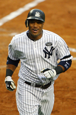 NEW YORK - OCTOBER 20:  Robinson Cano #24 of the New York Yankees reacts after he scored on his solo home run in the bottom of the third inning against the Texas Rangers in Game Five of the ALCS during the 2010 MLB Playoffs at Yankee Stadium on October 20