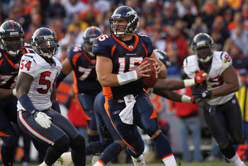 DENVER - DECEMBER 26:  Quarterback Tim Tebow #15 of the Denver Broncos rolls out and looks to deliver a pass against the Houston Texas at INVESCO Field at Mile High on December 26, 2010 in Denver, Colorado. The Broncos defeated the Texans 24-23.  (Photo b