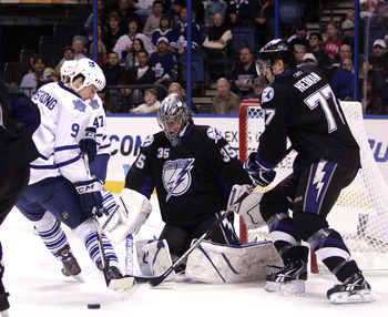 TAMPA, FL - JANUARY 25:  Dwayne Roloson #35 of the Tampa Bay Lightning makes a save against the Toronto Maple Leafs at St. Pete Times Forum on January 25, 2011 in Tampa, Florida.  (Photo by Justin K. Aller/Getty Images)