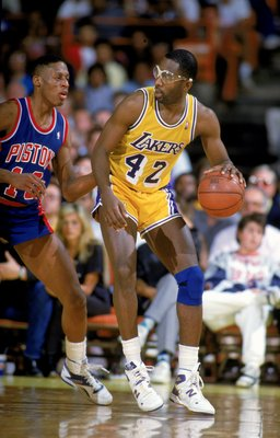 Undated: James Worthy #42 of the Los Angeles Lakers dribbles the ball during a game against the Detroit Pistons.   Mandatory Credit: Rick Stewart  /Allsport