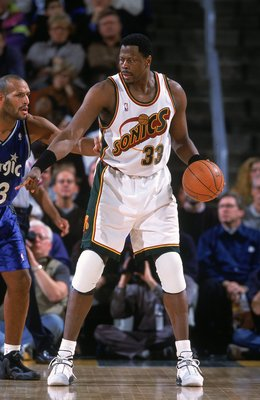 12 Dec 2000:  Patrick Ewing #33 of the Seattle SuperSonics dribbles the ball as John Amaechi #13 of the Orlando Magic gaurds him during the game at the Key Arena in Seattle, Washington.  The SuperSonics defeated the Magic 97-92.    NOTE TO USER: It is exp