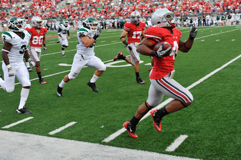 COLUMBUS, OH - SEPTEMBER 25:  Jaamal Berry #4 of the Ohio State Buckeyes races down the sideline on a 67-yard touchdown run in the fourth quarter against the Eastern Michigan Eagles at Ohio Stadium on September 25, 2010 in Columbus, Ohio. Ohio State defea