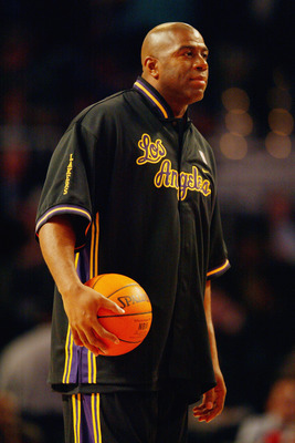 ATLANTA - FEBRUARY 8:  Ervin 'Magic' Johnson of the Los Angeles Team looks on before the Jeep Hoop it Up Game during the 2003 NBA All Star weekend at Philips Arena on February 8, 2003 in Atlanta, Georgia.  NOTE TO USER: User expressly acknowledges and agr