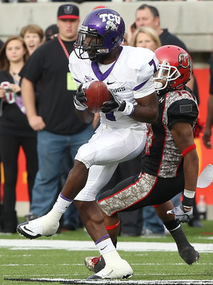 SALT LAKE CITY, UT - NOVEMBER 6: Greg McCoy #7 of the TCU Horned Frogs intercepts the ball from Reggie Dunn #14 the Utah Utes during the second half of an NCAA Football game November 6, 2010 at Rice-Eccles Stadium in Salt Lake City, Utah. TCU Beat Utah 47