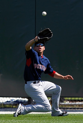 SARASOTA, FL - MARCH 27:  Outfielder Jacoby Ellsbury #2 of the Boston Red Sox  catches a fly ball against the Baltimore Orioles during a Grapefruit League Spring Training Game at Ed Smith Stadium on March 27, 2010 in Sarasota, Florida.  (Photo by J. Meric