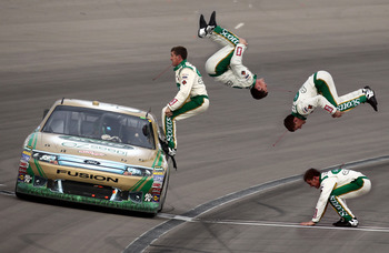 LAS VEGAS, NV - MARCH 06:  (***EDITOR'S NOTE*** COMPOSITE PHOTO ILLUSTRATION CREATED USING MULTIPLE IMAGES) Carl Edwards, driver of the #99 Scotts/Kellogg's Ford, celebrates with a flip from his car after winning the NASCAR Sprint Cup Series Kobalt Tools
