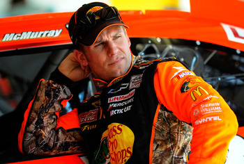 DAYTONA BEACH, FL - FEBRUARY 19:  Jamie McMurray, driver of the #1 Bass Pro Shops Chevrolet, looks on in the garage area during practice for the NASCAR Sprint Cup Series Daytona 500 at Daytona International Speedway on February 19, 2011 in Daytona Beach,