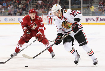 GLENDALE, AZ - FEBRUARY 12:  Patrick Sharp #10 of the Chicago Blackhawks skates with the puck under pressure from Kyle Turris #91 of the Phoenix Coyotes during the NHL game at Jobing.com Arena on February 12, 2011 in Glendale, Arizona. The Coyotes defeate