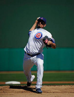 MESA, AZ - MARCH 09:  Matt Garza #17 pitcher of the Chicago Cubs throws a ptich against the Kansas City Royals during the spring training baseball game at HoHoKam Stadium on March 9, 2011 in Mesa, Arizona.  (Photo by Kevork Djansezian/Getty Images)