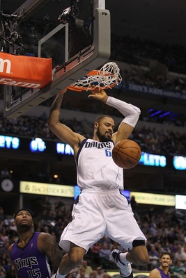 DALLAS, TX - FEBRUARY 16:   Center Tyson Chandler #6 of the Dallas Mavericks makes the slam dunk against the Sacramento Kings at American Airlines Center on February 16, 2011 in Dallas, Texas.  NOTE TO USER: User expressly acknowledges and agrees that, by