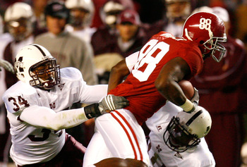 TUSCALOOSA, AL - NOVEMBER 15:  Tight end Nick Walker #88 of the Alabama Crimson Tide breaks a tackle by K.J. Wright #34 and Marcus Washington #18 of the Mississippi State Bulldogs during the game at Bryant-Denny Stadium on November 15, 2008 in Tuscaloosa,