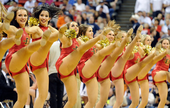 LAS VEGAS, NV - MARCH 12:  San Diego State Aztecs cheerleaders perform during the championship game of the Conoco Mountain West Conference Basketball tournament against the Brigham Young University Cougars at the Thomas & Mack Center March 12, 2011 in Las